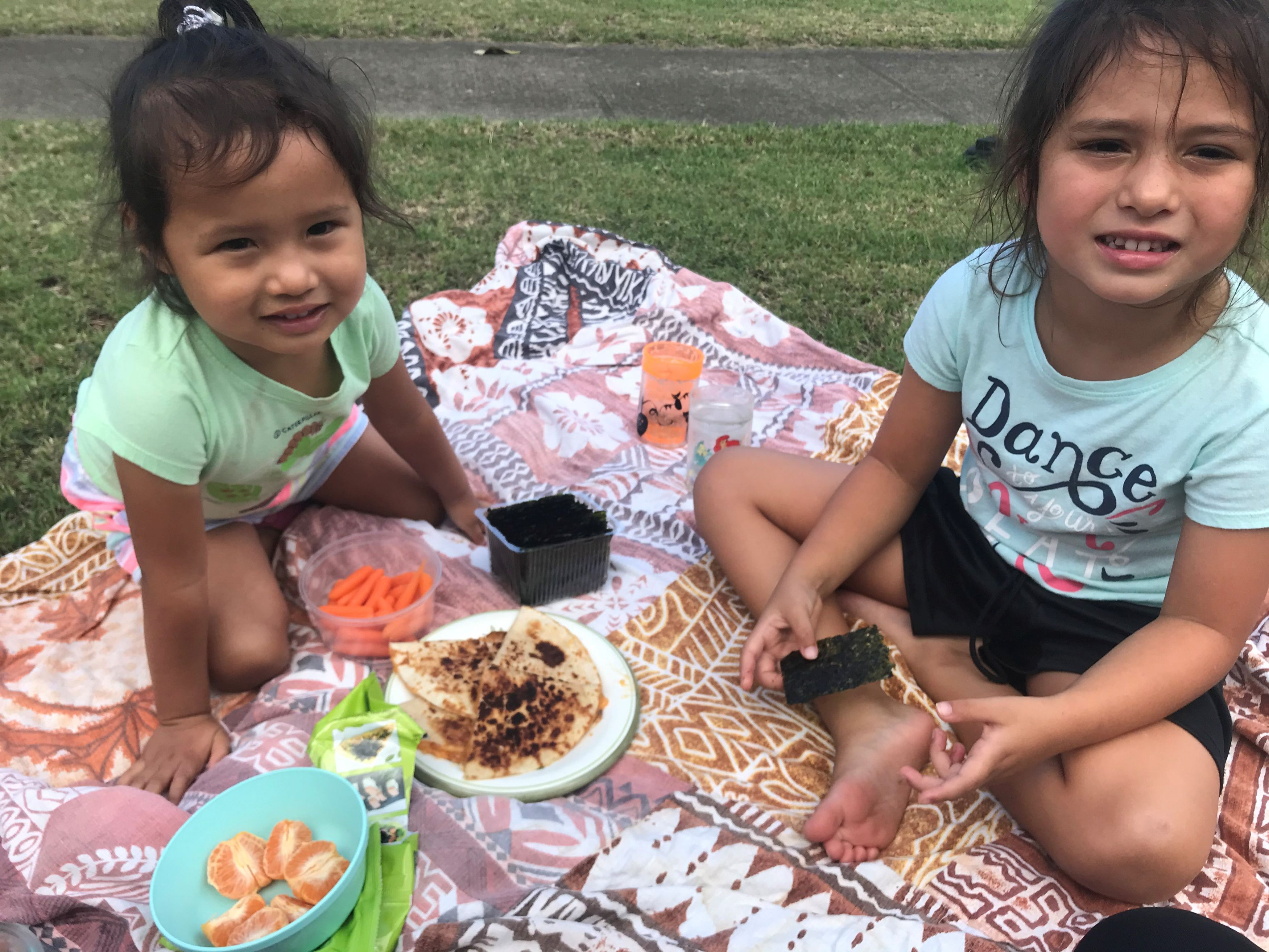 My girls having a picnic in the yard
